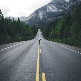 A friend longboarding down the centre of the road in Jasper, AB, Canada