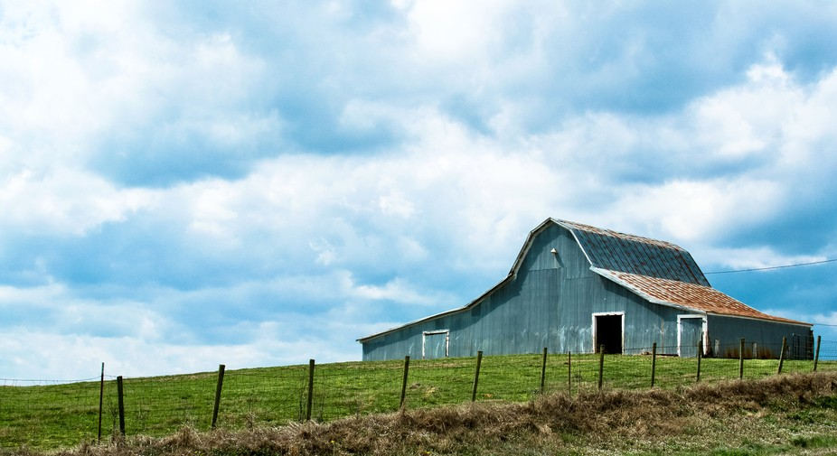 A cool blue barn off the highway.