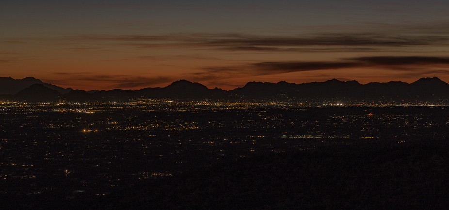 The city of Tucson facing west at summer dusk time.