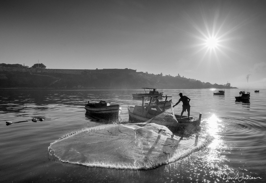 A favorite of mine from Havana. I watched this fisherman for about an hour as the sun rose, poise...