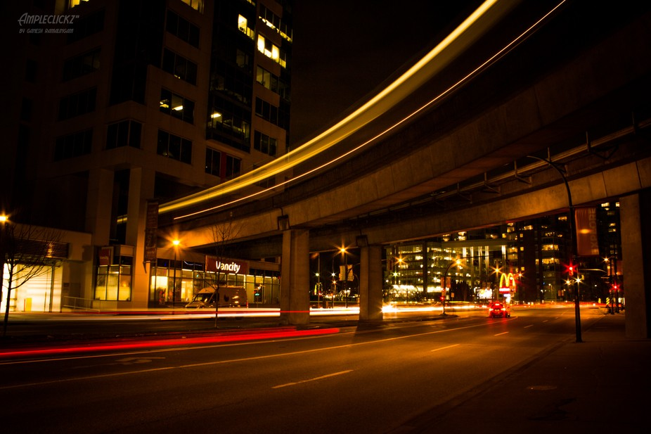 Light Trail showing Skytrain and Road Traffic - Vancouver
