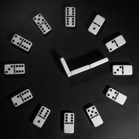 domino pieces in a shape of a clock