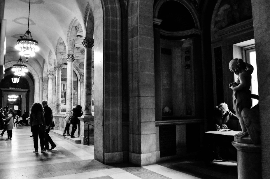Boston Public Library. I loved the contrast of the lighted hallway where people are socializing a...