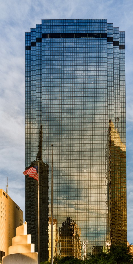 This was late in the day. It was 24mm and the distortion was partially corrected in Lr. I had liked the colors and clouds reflected in the tallest building.