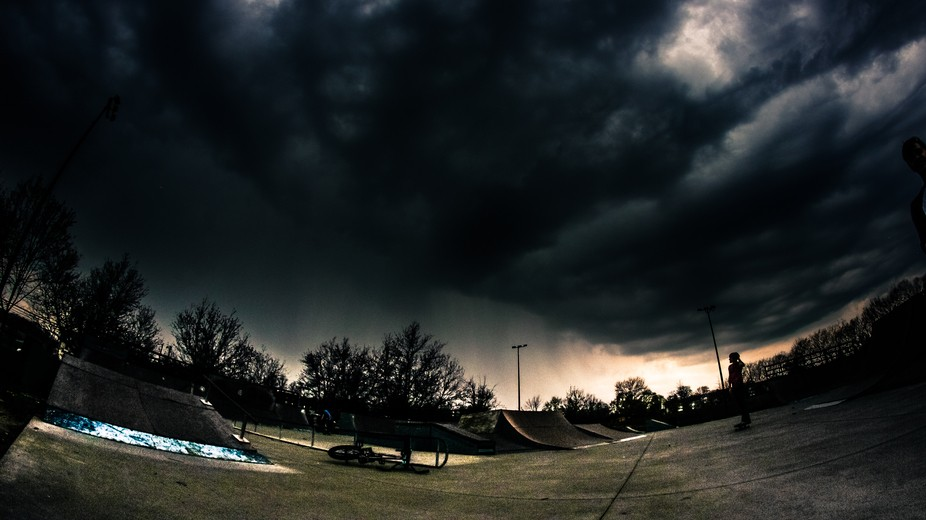 just as a down pour approaches in the distance at the skatepark  shot with canon t3i rokinon 8mm ...