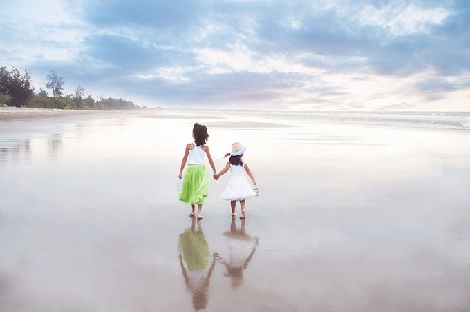 sisters by icyabi5 - Kids And Water Photo Contest