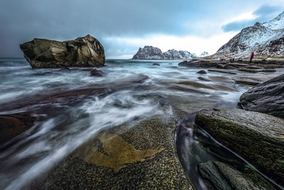 Movement of water on the shores of cold Norwegian Sea at evening time.