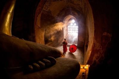 Buddhist novice praying