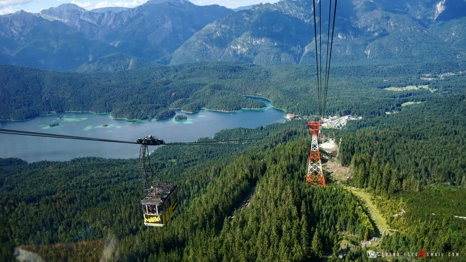 A view from the cabelcar to the highest mountain of germany on the Lake Eibsee in Bavaria, Germany