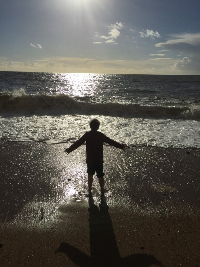 My son welcoming the sea in the Isle of Wight