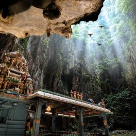Batu Caves are formed in a limestone hill on the outskirts of Kuala Lumpur, Malaysia. The main temple of Murugan is a Hindu shrine that sits in t...