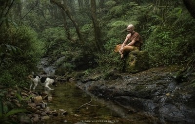Buddhist monk with his dog...