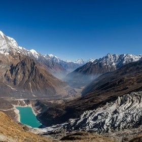A view on the way up to Manaslu base camp - far beneath lies the Nubri valley and turquoise Birendra lake at the foot of impressive Manaslu glaci...