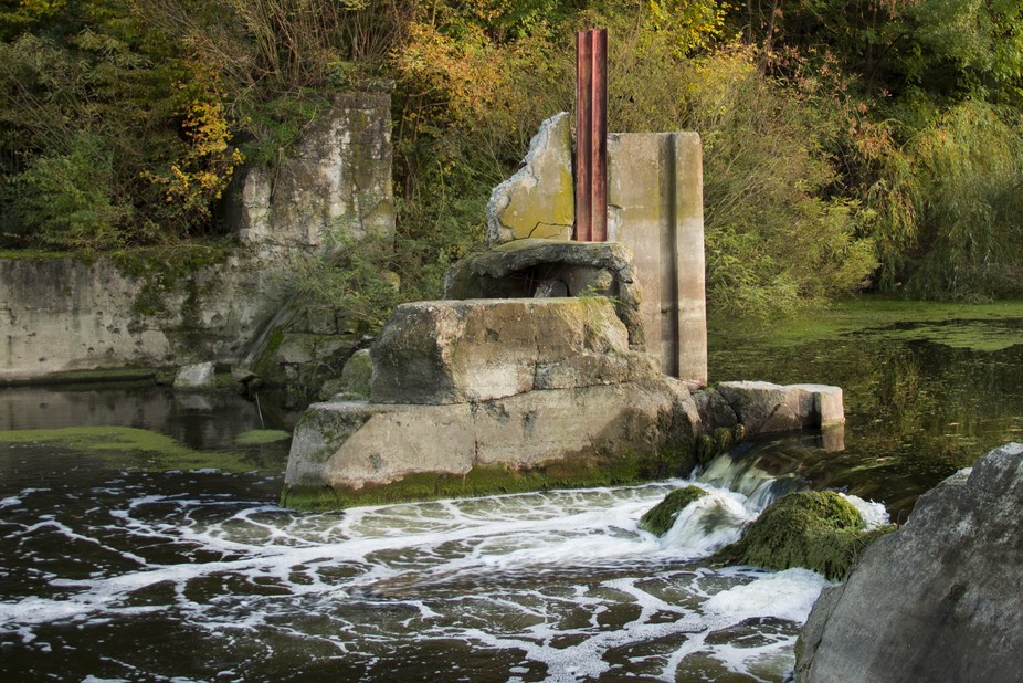 Peaceful spot by a broken bridge