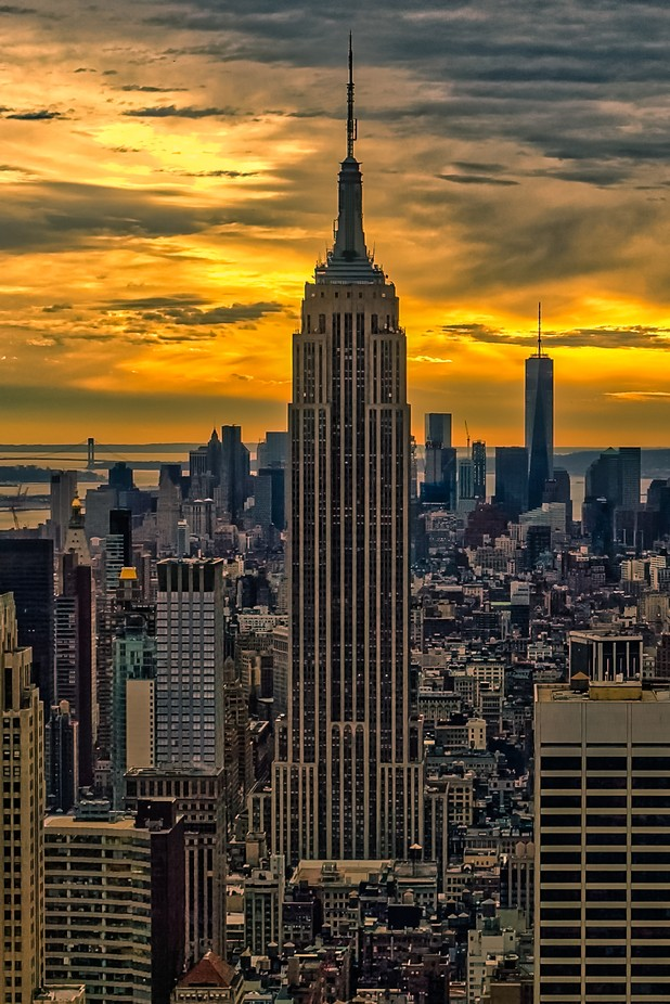 Empire State Building. Sunset colors enhanced. Picture taken in New-York, Manhattan, USA.