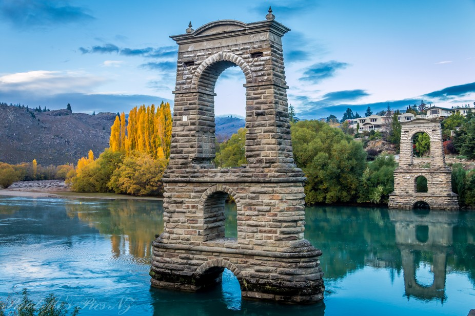 The stone turrets from the old bridge that crossed the river at Alexandra South Island New Zealan...