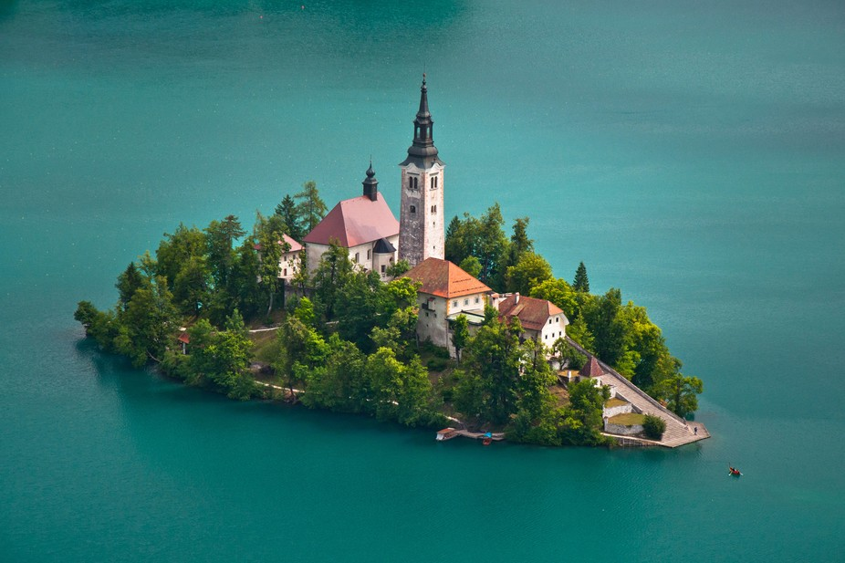 Located in the middle of Lake Bled, Slovenia is the the Church of the Assumption. This building t...