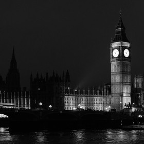 Night shot showing Big Ben and the Houses of Parliament in London from across the Thames. Part of Westminster Abbey can just been seen peeking ou...