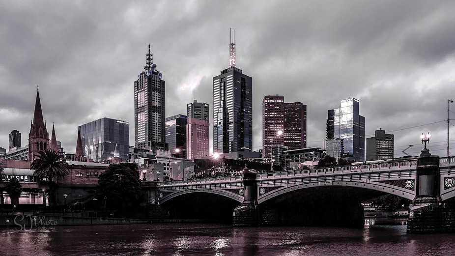 A dark look at the towers on Collins Street and the Princess Bridge (Constructed in 1888) in Melb...