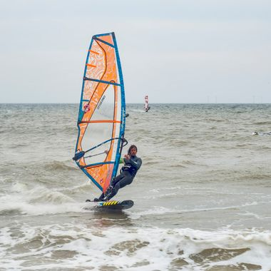 Wind-surfer at speed at Colwyn Bay.