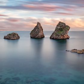 "Three months waiting to take this shot. ""Legend says that -  the Poseidon God put these two magnificent rocks as a testimony to the courage ..."