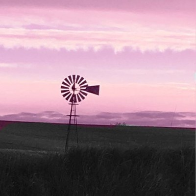 I saw a pretty pink color in the sky this morning and I tracked it to this field. Absolutely Stunning. #pinksky #sky #sunrise #stunning #nature #windmill #openfields #belleplaine #Iowa #outdoors #beautifulview #beautyinnature #beauty #gravelroad #unexpect