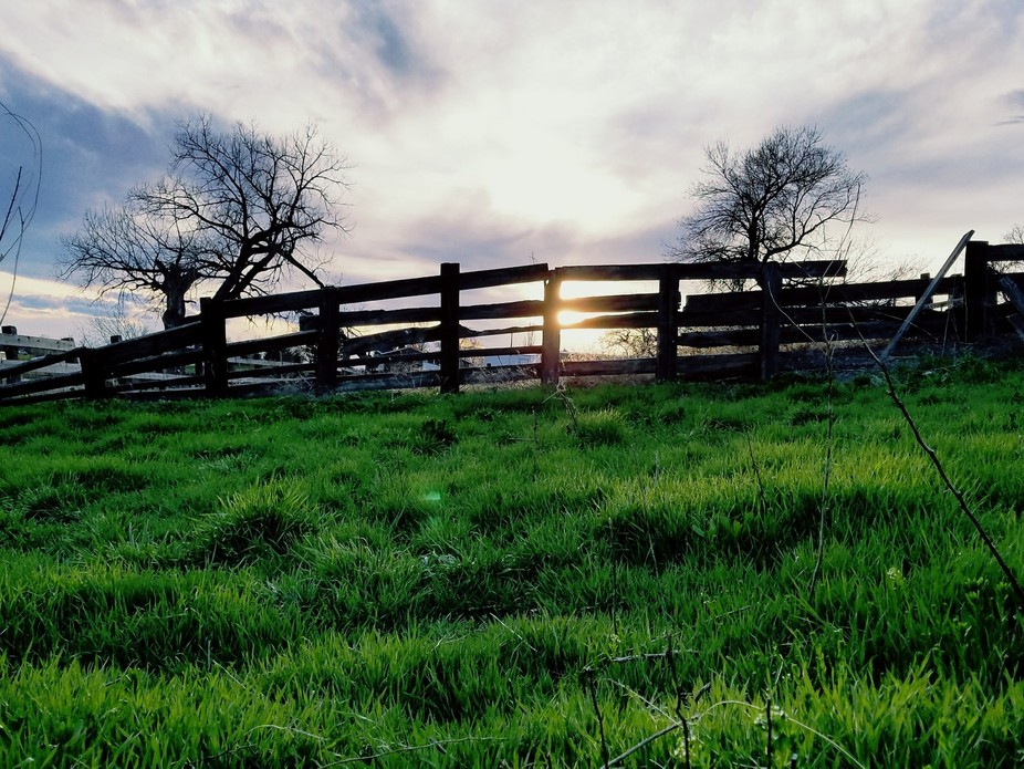 An old fence on our farm at sunset in Montana.