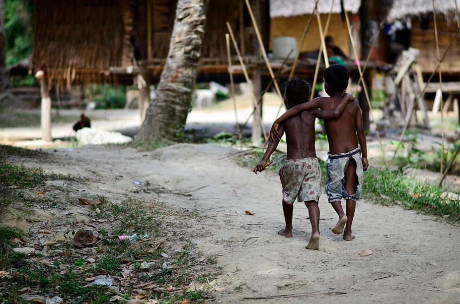 PALAWAN - BATAK TRIBE, PHILIPPINES - FEBRUARY 2016: Two friends at Batak tribe village near San R...