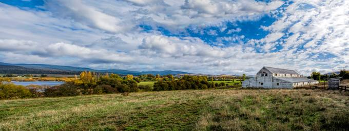 Panorama of the old Shearing Shed with the Derwent River flowing bye in the distance. At Lawrenny, Ouse, Tasmania