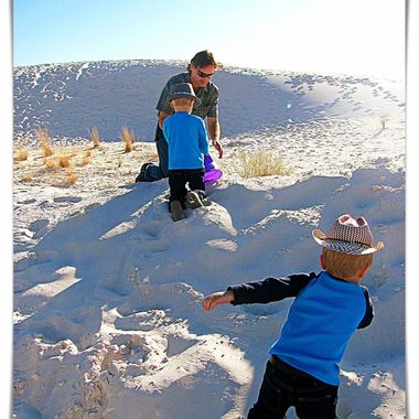 Playing in the sand at White Sands in New Mexico.