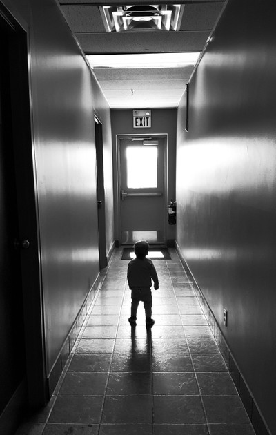 Little one contemplating the emergency exit