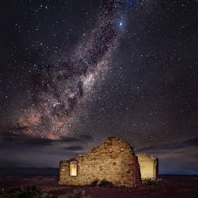The milky way over a house ruin, Flinders Ranges, outback South Australia. The milky way rising is often referred to as the emu rising, as it loo...