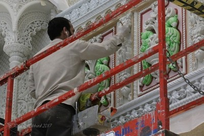 Volunteer workers paint the indise walls of the BAPS Temple in NJ