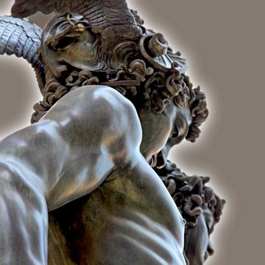 Showing the three faces on Cellini's sculpture of Perseus on display in the Loggia dei Lanzi in Florence.