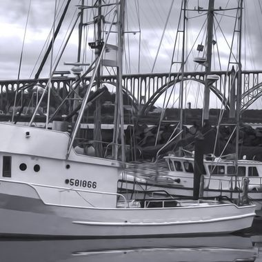 Fishing boat in the harbor of Newport Oregon .