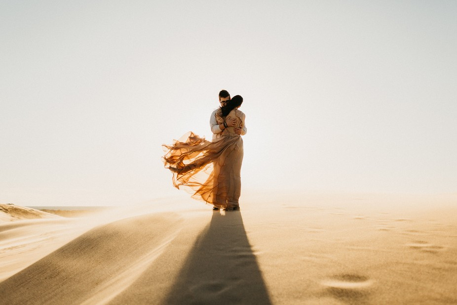 Despite the frigid Lake Michigan wind blowing sand in their eyes, Sierra & Gentry embrace...