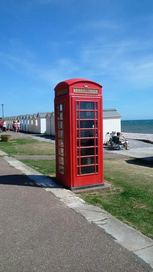 Traditional British telephone box captured at Budleigh Salterton on the sea front.