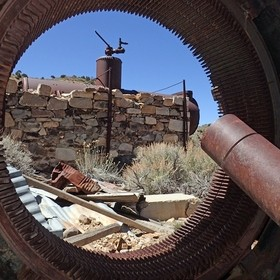 The boiler at Jefferson Mining District, as seen through an old generator right below the head frame and ore bin.