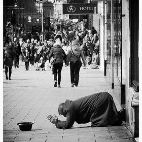 On Princes Street. People staying well away while the beggar prays for money. Of course I did give him money!