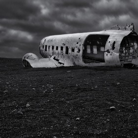 The photograph is from a very well known location in South of Iceland. This hauntingly beautiful rusting plane is a US Navy plane that crashed on...