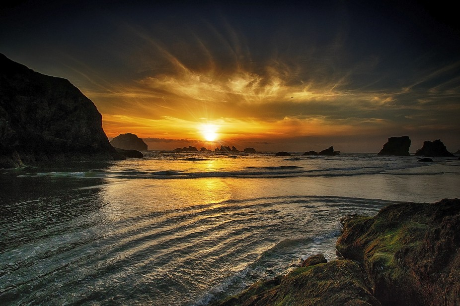 This was taken at Face Rock in Bandon, Oregon --- if you look at the left of the sunset, you will...