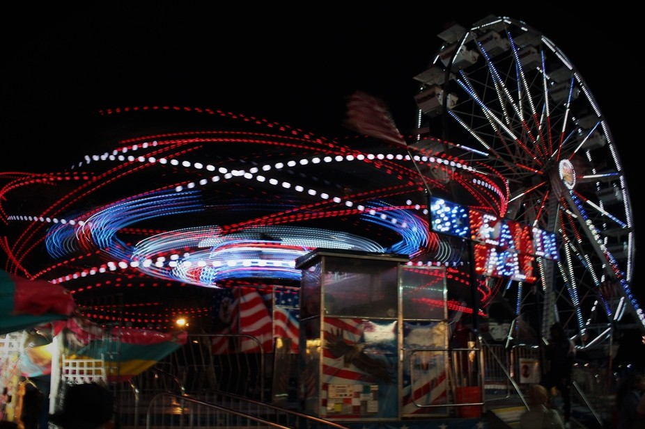 I had my camera handy as I passed by a parking lot carnival and snapped this handheld long exposu...