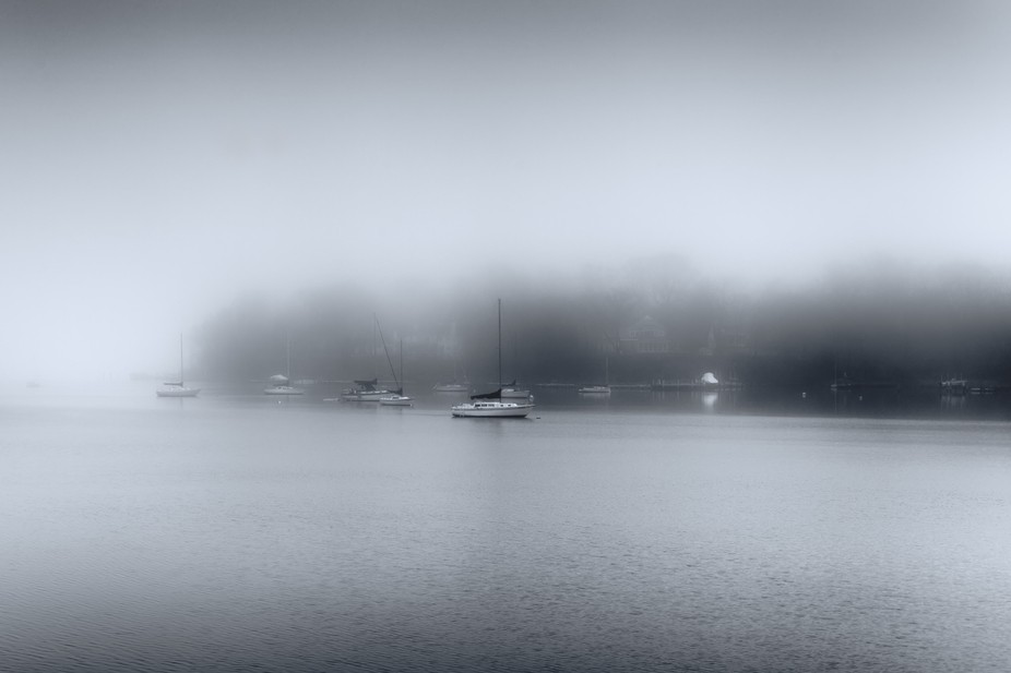Sailboats along the inlet.  A foggy morning on the water
