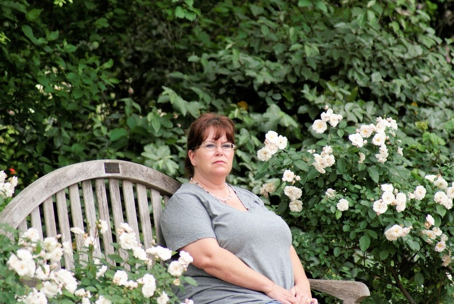 My wife relaxing and enjoying the weather at the gardens.