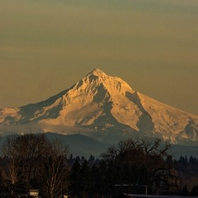 Mount Hood overlooks the Colombia Gorge in Oregon the low sun makes the snow covered peak glow to a absolute breath taking sight