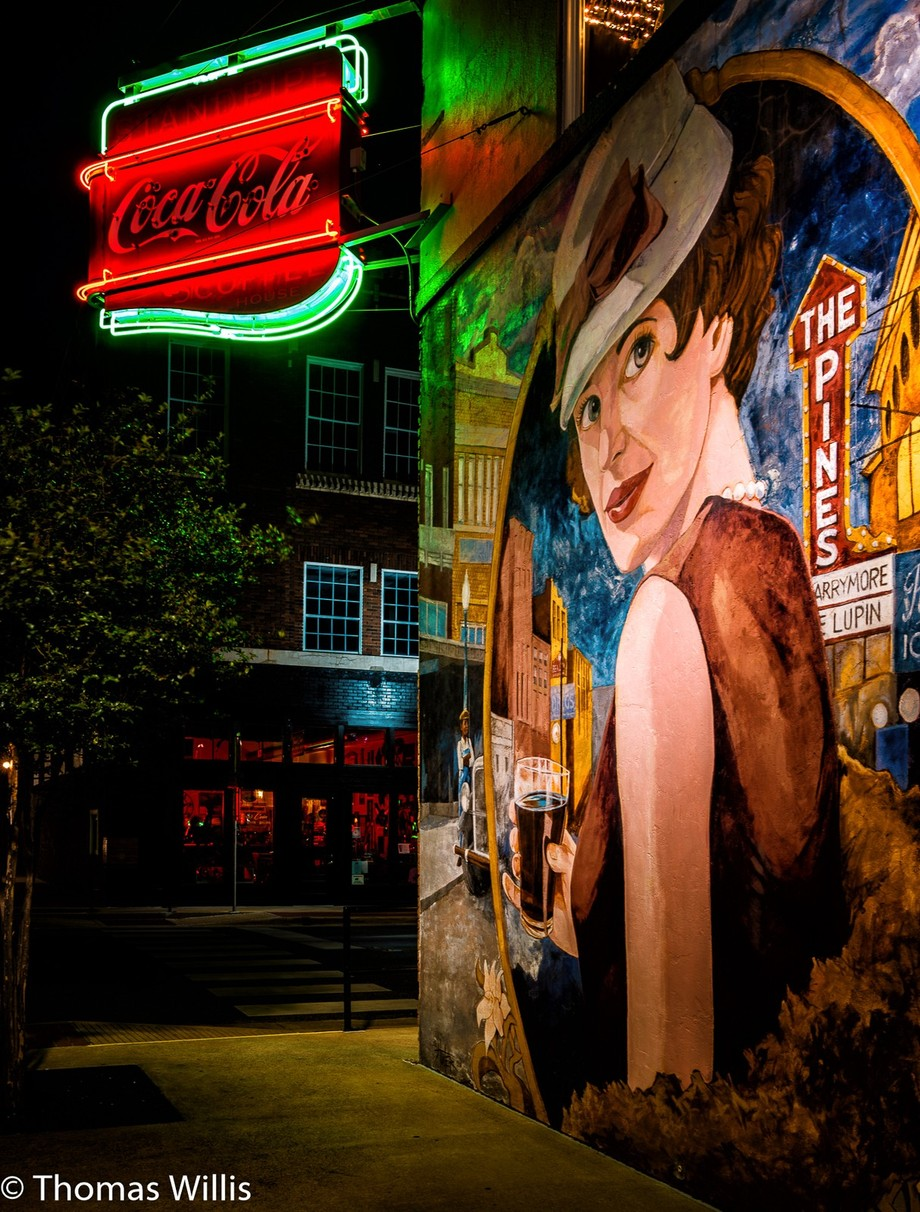 Downtown in the community of Lufkin, TX, USA. This is a multi-second exposure of a mural and an old Coca Cola sign.