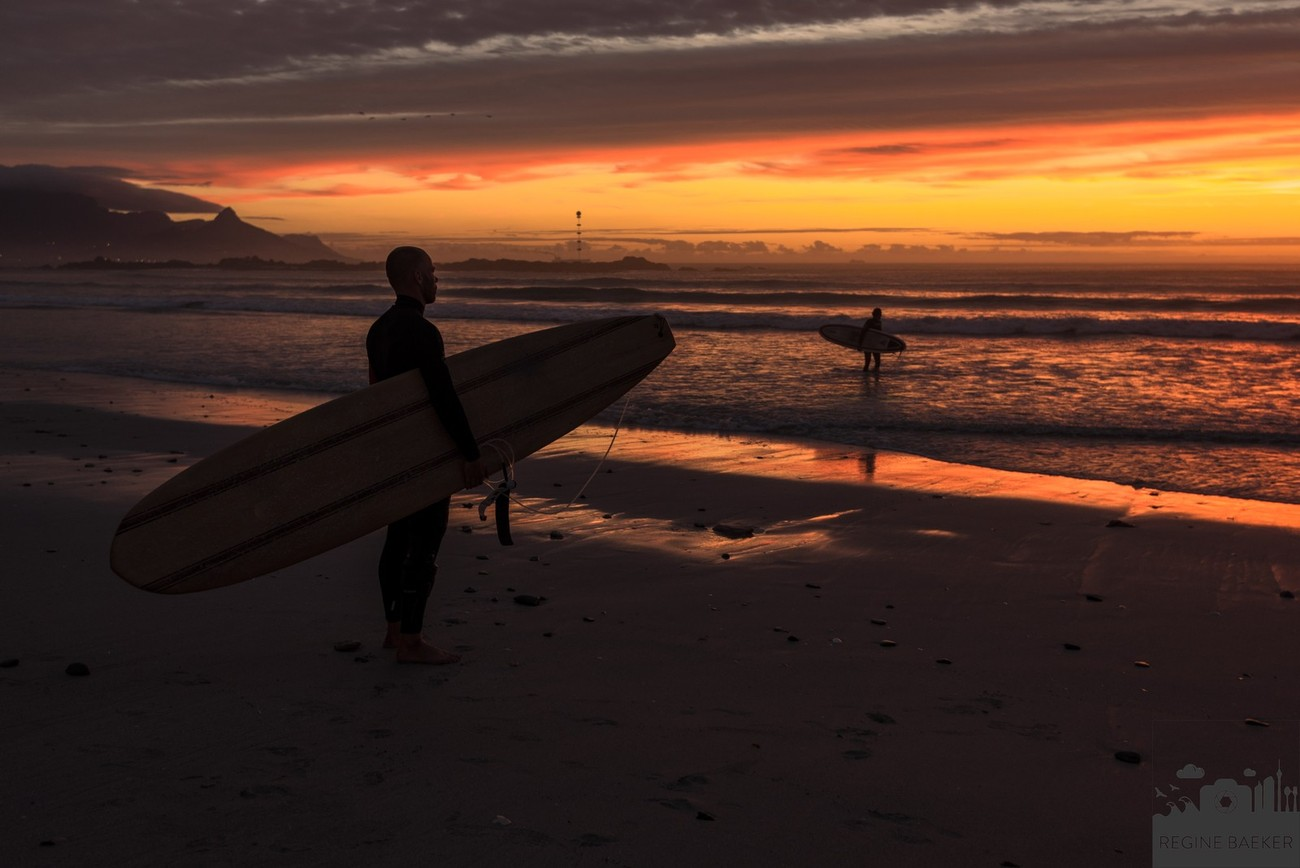 I stayed a long time till sunset at Big Bay Beach in Capetown to watch to the surfers,.Th elight became more and more better and the sky more and more dramatically