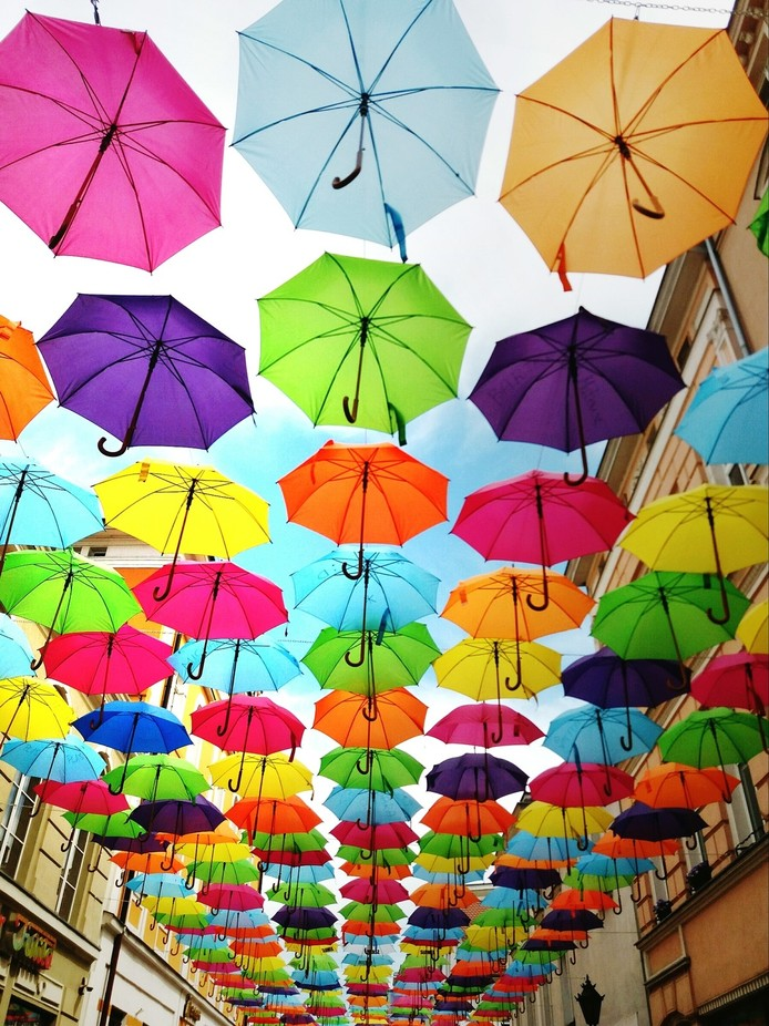 Umbrellas hanging above the Street in Leszno, Poland. It was just a moment... Taken with smartpho...