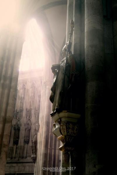 Statue of a saint in sun shine