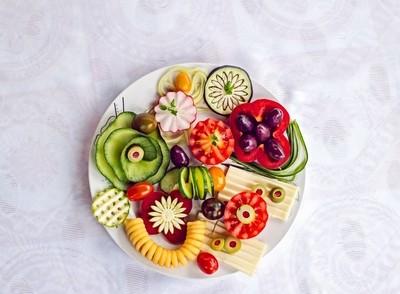 Vegetarian breakfast plate on white silk background, top view